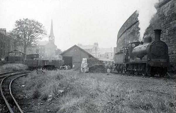 John Lyon Coal yard at Cecil Street - Paisley East line is on top of the wall, Sherwood Church in background 1949  - GH Robin